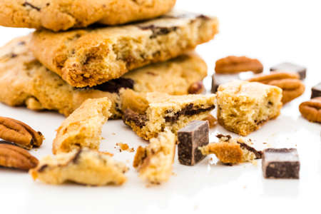 baked treat: Gourmet chocolate chunk cookies with toasted pecans. Stock Photo