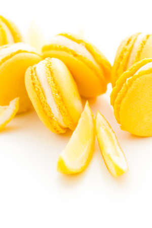 Gourmet small colorful French macarons with lemon flavor.