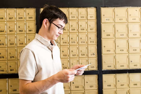 old envelope: College student checking mail at mailboxed.