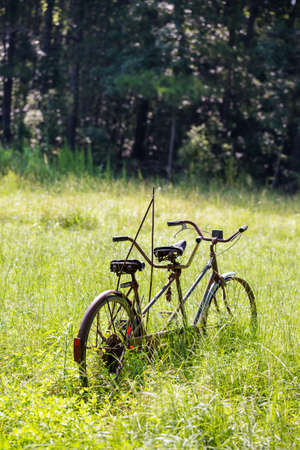 Old tandem bicycle on Southern farm. photo