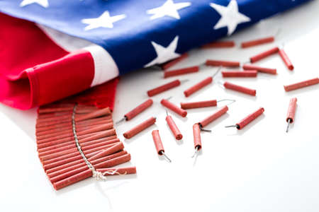 Roll of firecrackers with American flag on a white background. Reklamní fotografie