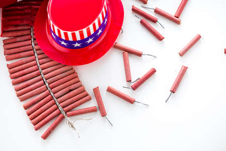 noise maker: Roll of firecrackers with American flag on a white background. Stock Photo