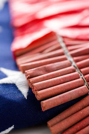 Roll of firecrackers with folded American flag.