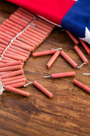 noise maker: Roll of firecrackers with folded American flag.