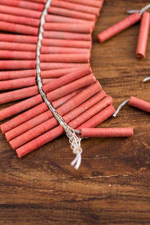 Roll of firecrackers on wood table. Reklamní fotografie