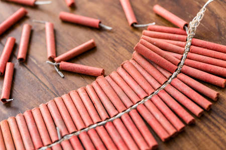 noise maker: Roll of firecrackers on wood table. Stock Photo