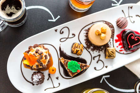 assorted petite: Tasting of wine and pattie chocolate pastries at the chocolate and beer and wine pairing party.