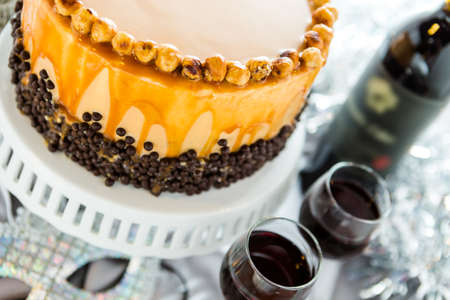 pastrie: Chocolate beer and wine pairings. Heavenly Hazelnut Torte with wine for celebrating New Year. Stock Photo