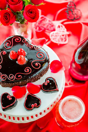 flourless chocolate cake: Chocolate beer and wine pairings. Raspbeverly Flourless Cake with Funkwers Raspberry beer for Valentines day. Stock Photo