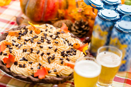 Chocolate beer and wine pairings. White Chocolate Salted Caramel Pumpkin Cream Pie with beer for Thanksgiving. Stock Photo