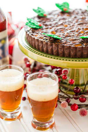 pastrie: Chocolate beer and wine pairings. Nutcracker Sweet Tart with beer for Christmas. Stock Photo