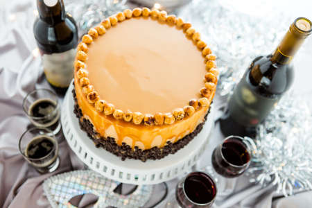 Chocolate beer and wine pairings. Heavenly Hazelnut Torte with beer and wine for celebrating New Year. photo
