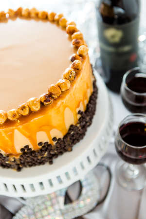 Chocolate beer and wine pairings. Heavenly Hazelnut Torte with wine for celebrating New Year. photo