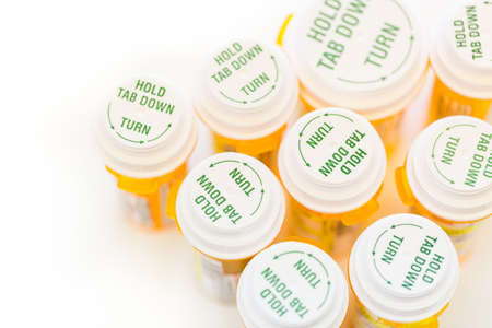 Prescription pills in yellow bottles on a white background. Stock fotó