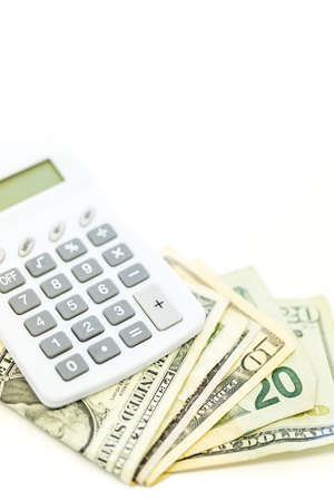 白い背景に電卓で米ドルを折ら。 写真素材