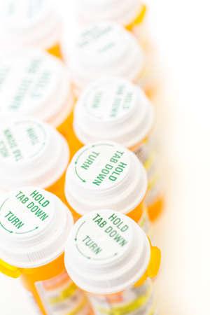 Prescription pills in yellow bottles on a white background. Stock fotó