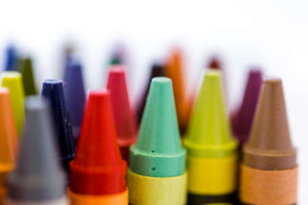 office supplies: Multicolored crayons on a white background. Stock Photo