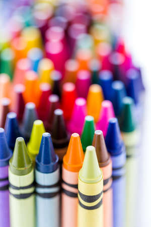 Multicolored crayons on a white background. Imagens