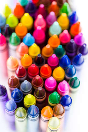 grease paint: Multicolored crayons on a white background. Stock Photo