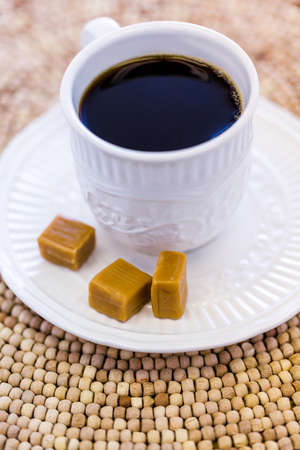 energizing: Hot coffee with caramel canies on the table. Stock Photo