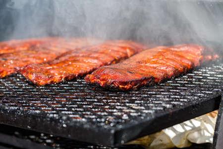 Baby back ribs prepared in smoker. 스톡 콘텐츠