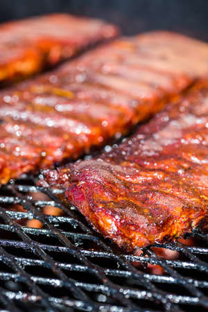 Baby back ribs prepared in smoker. Stock Photo