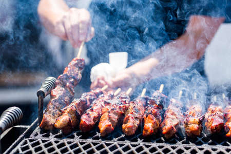 summer festival: Pork on skewers cooked on barbecue grill. Stock Photo