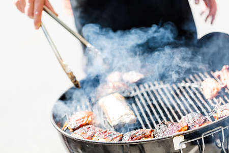 Summer outdoor cooking on barbecue grill. Stock Photo