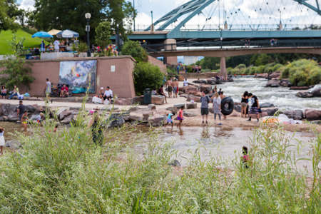 Typical summer weekend at Confluence Park in downtown Denver, Colorado.