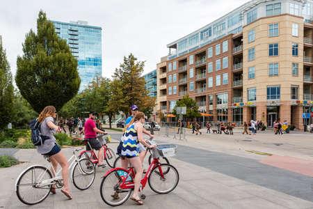 Denver, Colorado, USA-August 31, 2014. Biking on weekend in downtown Denver, Colroado.