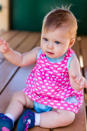 Cute baby girl playing on tot lot. photo