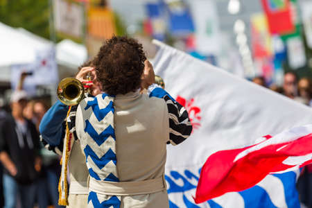 Flad trowing performance at anual Italian Festival on streets of Belmar, Colorado.