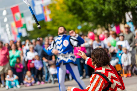 flad: Lakewood, Colorado, USA-September 6, 2014. Flad trowing performance at anual Italian Festival on streets of Belmar, Colorado.