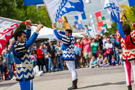 Lakewood, Colorado, USA-September 6, 2014. Flad trowing performance at anual Italian Festival on streets of Belmar, Colorado.