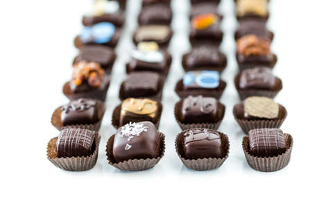 Delicious gourmet chocolate truffles hand made by professional chocolatier. Imagens