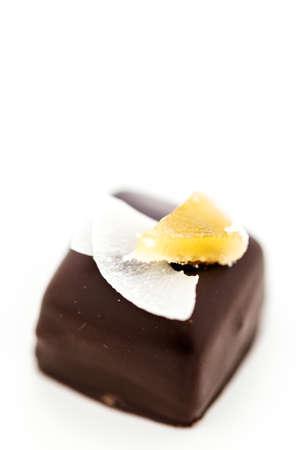 Gourmet pina colada caramel truffle on a white background.