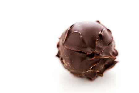 Gourmet dark chocolate truffle on a white background. Reklamní fotografie