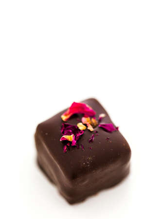 Gourmet wine and roses chocolate truffle on a white background.