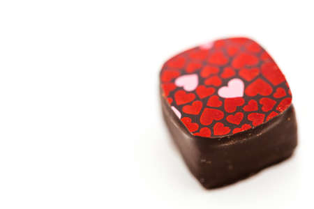 Gourmet strawberries and champaigne truffle on a white background.