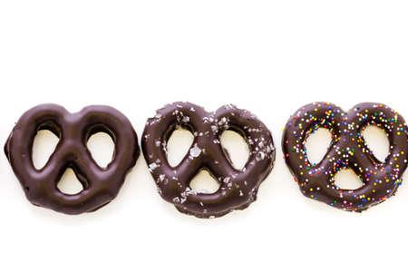 pretzel: Gourmet chocolate covered pretzels on a white background.