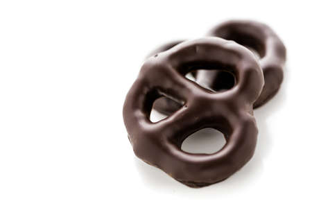 Gourmet chocolate covered pretzel on a white background.