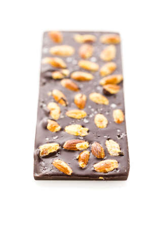 almighty: Gourmet almighty almond chocolate bar with sea salt on a white background. Stock Photo