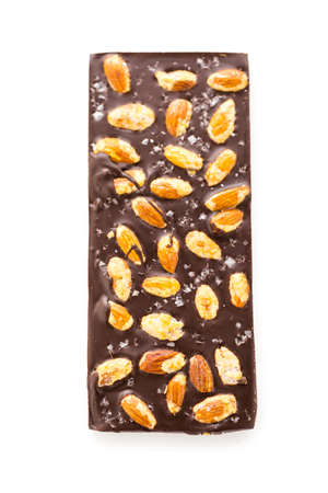 Gourmet almighty almond chocolate bar with sea salt on a white background. Stock Photo