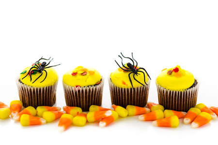 Assorted cupcakes with yellow and orange icing decorated for Autumn. photo