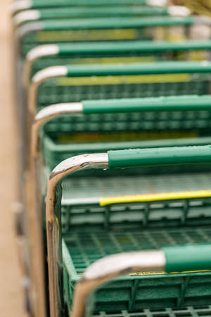 Large green shopping cart in a row. photo