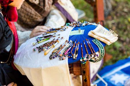 Display of vintage bobbin lace craft on historical ranch. Imagens