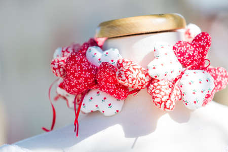 Handmade hearts made from white and red fabric.