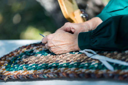 Rug Making: Making A Rug With Vintage Materials By Old Woman. Stock Photo