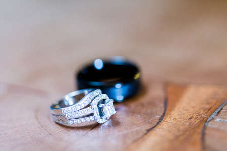 priced: Close up of wedding rings from precious metals.