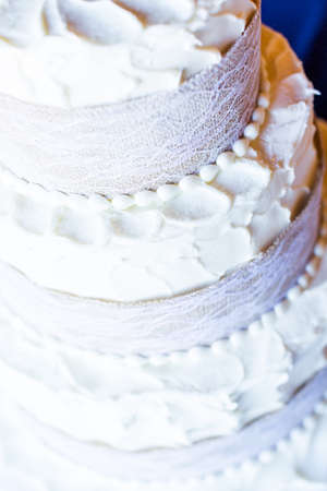 priced: Three stack simple wedding cake in banquet hall.
